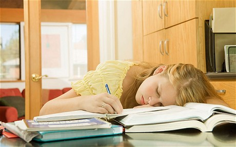 Teenage girl sleeping on school books. Image shot 2007. Exact date unknown....APEGGX Teenage girl sleeping on school books. Image shot 2007. Exact date unknown.