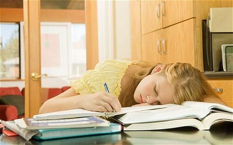 Teenage girl sleeping on school books. Image shot 2007. Exact date unknown....APEGGX Teenage girl sleeping on school books. Image shot 2007. Exact date unknown.